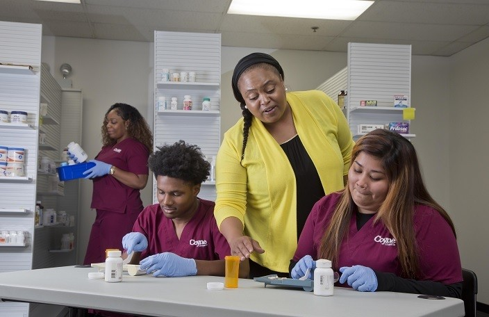 Male and Female Students taking a Pharmacy Technician Class