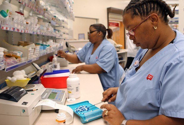 Walgreens pharmacy technicians refilling prescriptions
