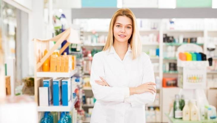 Female pharmacy technician working in a retail pharmacy