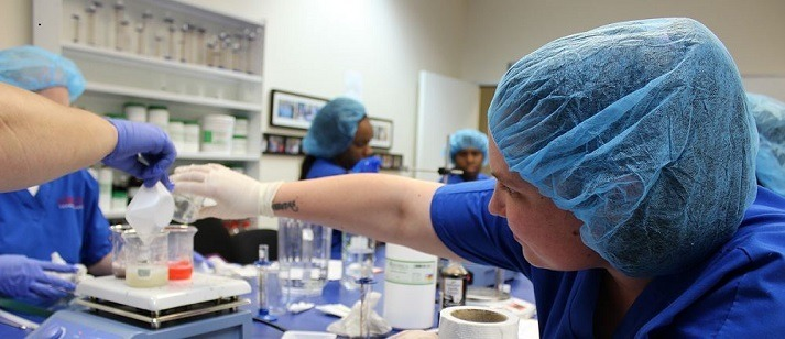 Pharmacy tech students studying labwork