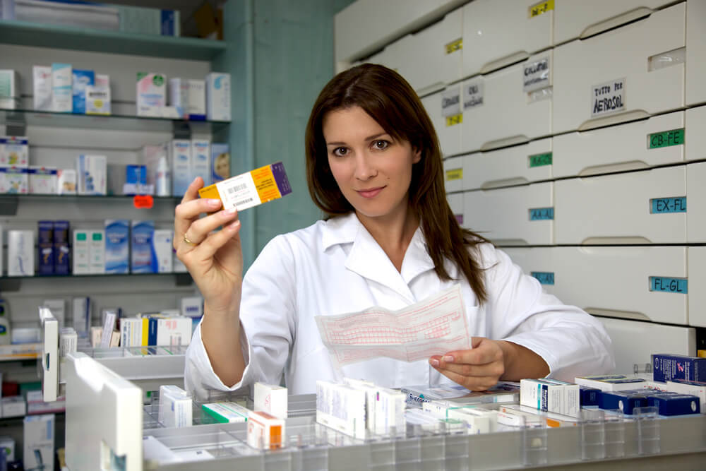 A female pharmacy technician working in a retail pharmacy