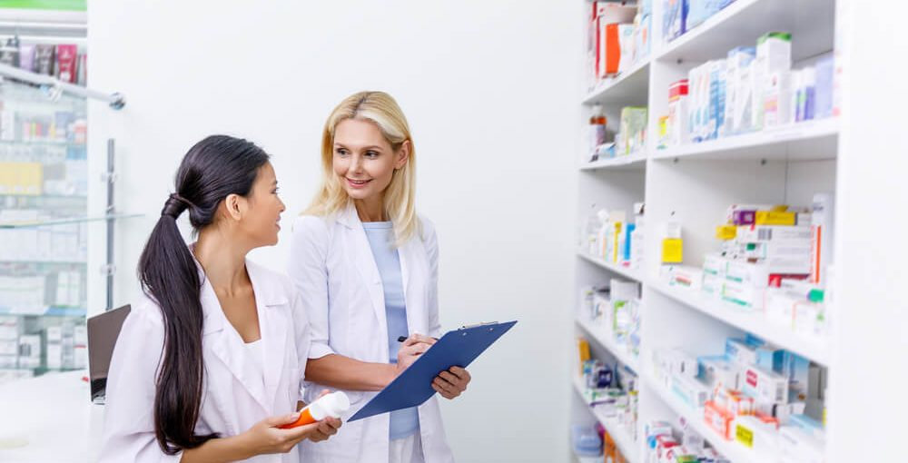 A pharmacist and a pharmacy tech in a drugstore