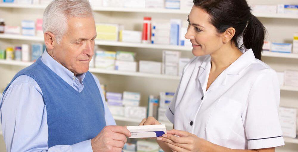 A female pharmacy tech assisting an elderly customer