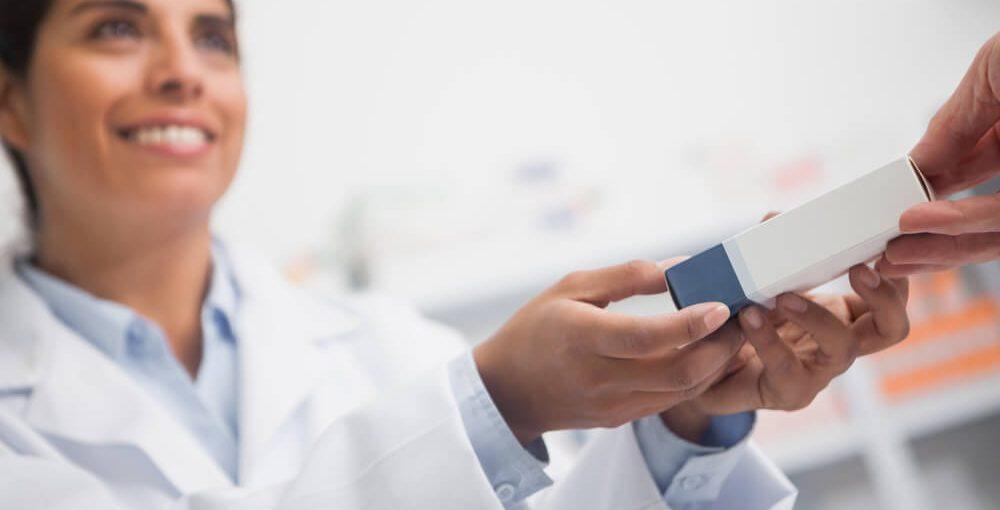 Pharmacy Technician Assisting a Customer
