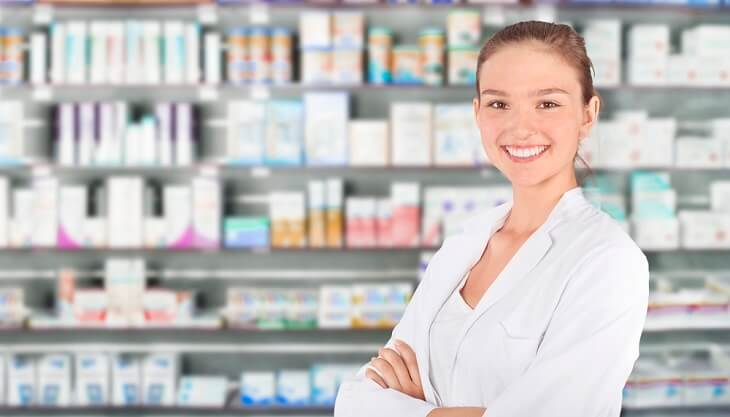 a young female pharmacy technician in a retail pharmacy.