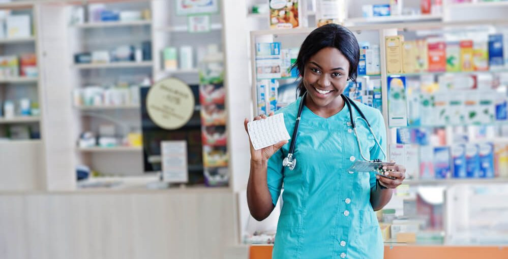 A young African American Pharmacy Technician Working in a Retail Pharmacy