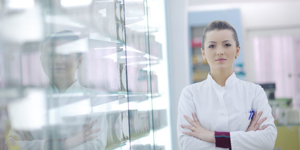 A female pharmacy technician trainee in a drugstore