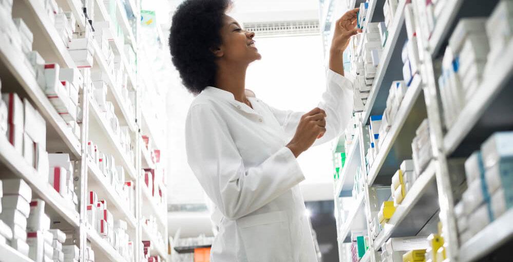 A female pharmacy technician trainee in a drugstore