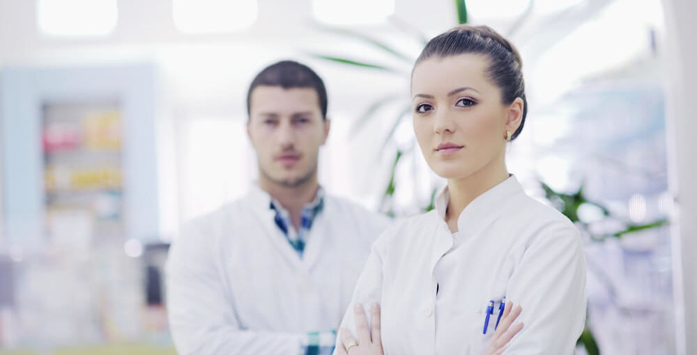 A team of male and female pharmacy techs working in a drugstore