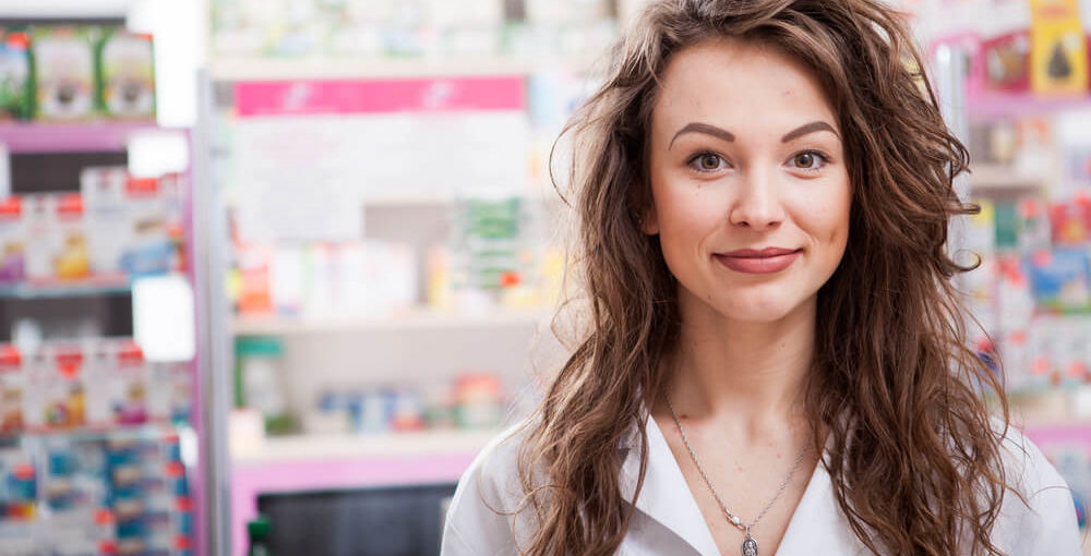 A female trained pharmacy technician working in a drugstore